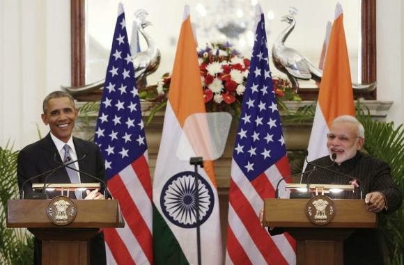 U.S. President Barack Obama and Indian Prime Minister Narendra Modi (R) smile after giving their opening statement at Hyderabad House in New Delhi January 25, 2015. CREDIT: REUTERS/ADNAN ABIDI