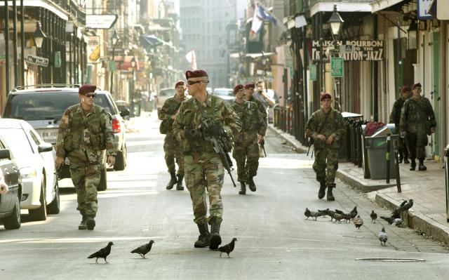 On Bourbon Street in New Orleans' famous French Quarter, paratroopers from Bravo Company, 2nd Battalion, 505th Parachute Infantry Regiment, 82nd Airborne Division, patrol nearly deserted streets. nesaranews.blogspot.com