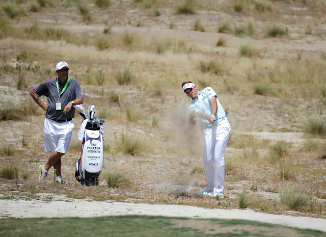 Ian Poulter, of England hits from the waste area on the fifth hole during a practice round for the U.S. Open golf tournament in Pinehurst, N.C., Tuesday, June 10, 2014. The tournament starts Thursday. (AP Photo/Eric Gay)