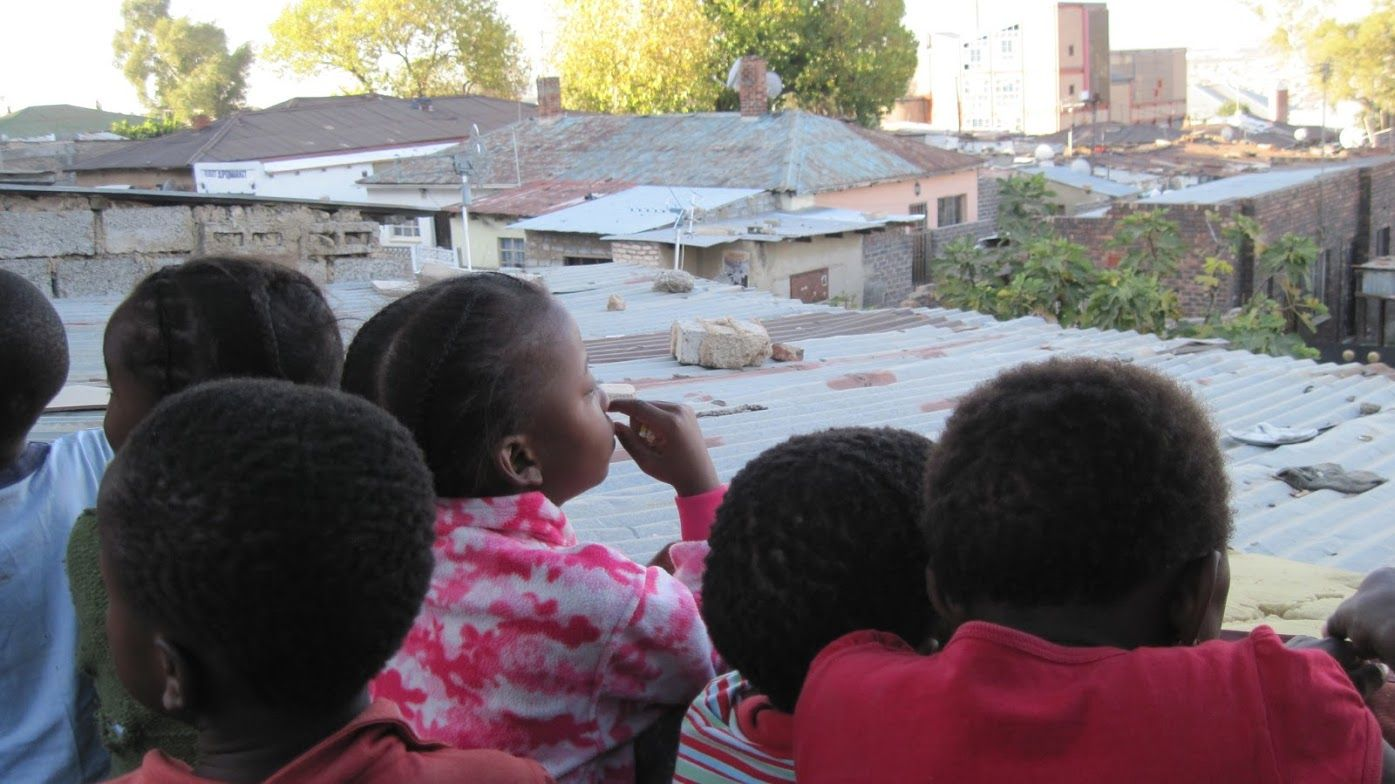 """More extreme storms and floods highlight just how inconsistent national infrastructures can be and which populations in a country aren't well served when the power goes out."" Children in Alexandra Township, South Africa (credit P. Toscano)"