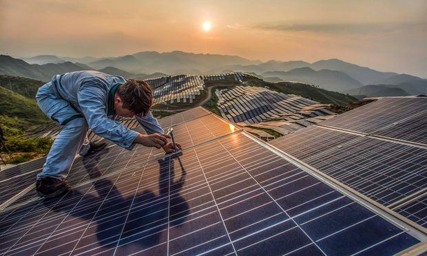 A worker at Xinyi photovoltaic power station in Songxi, China. China will lead the world for growth in renewable power, the IEA has predicted. Photograph: Feature China / Barcroft Images