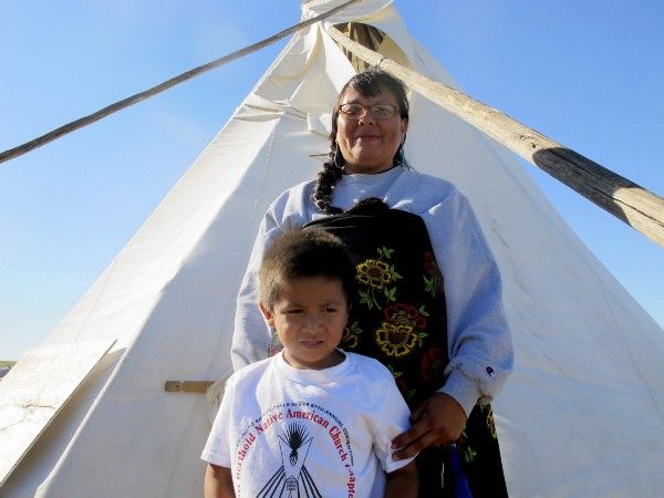 A Lakota Sioux and her 5-year-old son pose for a photo at a protest camp erected to halt the construction of the Dakota Access Pipeline. CREDIT: AP Photo/James MacPherson